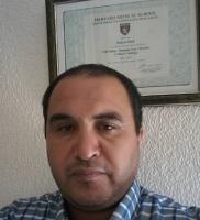 Dr. Karim Hnid