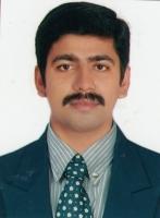 Dr. Binoy E B